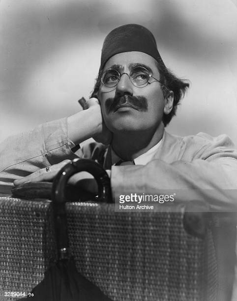 Julius 'Groucho' Marx one of the Marx Brothers a team of American film comedians He is wearing a fez for his role in 'A Night In Casablanca' a David...