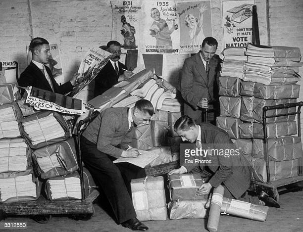 Men at work packing leaflets and posters at the Conservative Party's warehouse in preparation for the General Election