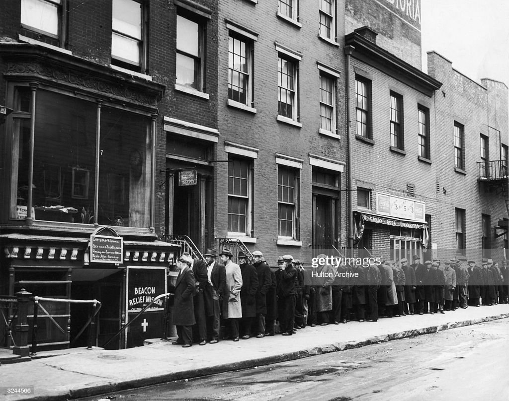Men wait in line to enter the Beacon Relief Mission on Bowery Street during the Great Depression, Manhattan, New York City.