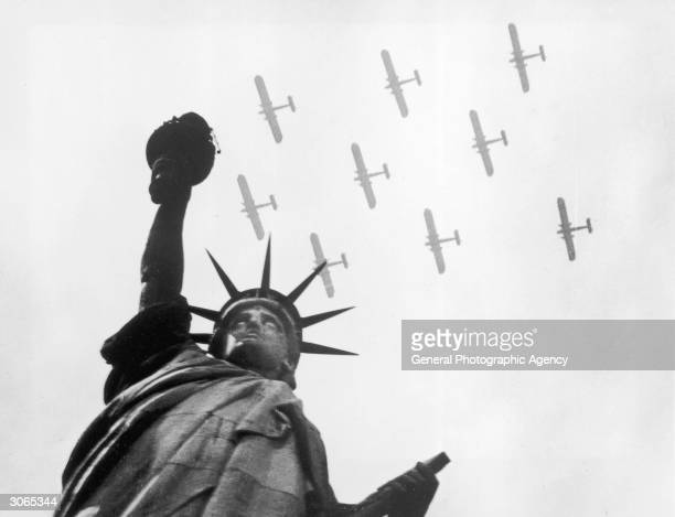 Military aircraft fly over the Statue of Liberty New York