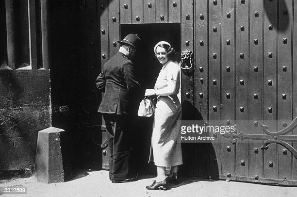 Miss Fay Taylour the famous racing driver at the gates of Holloway Prison