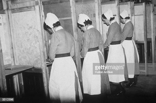 Nurses from Great Ormond Street hospital, recording their votes at the polling booth in Devonshire Street, London.