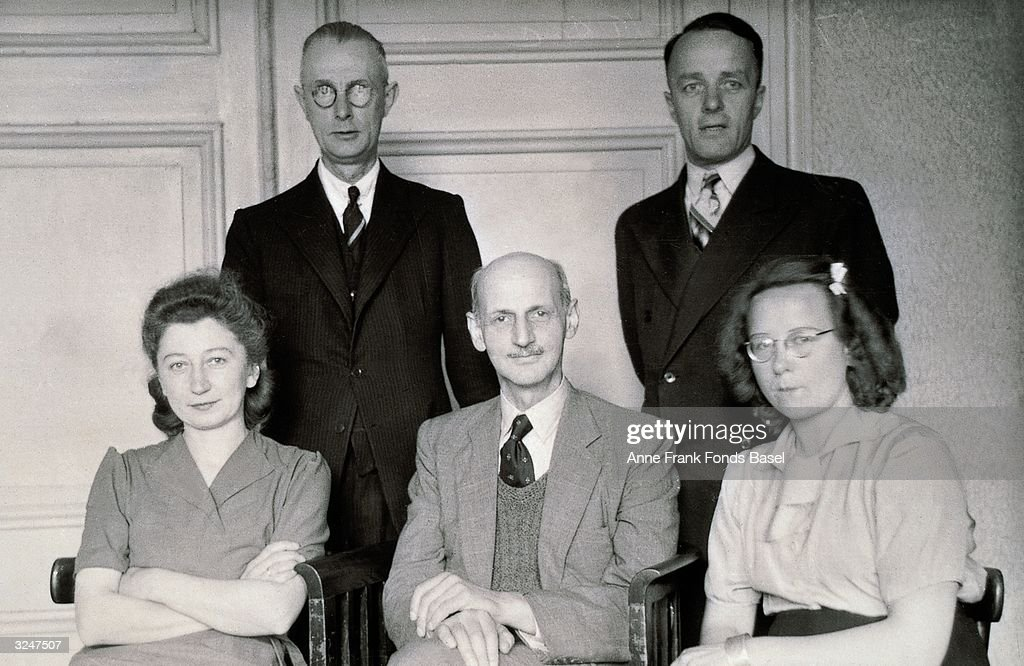 Portrait of Anne Frank's father, Otto Frank, surrounded by his office workers, c. 1935. Top row (L-R): Johannes Kleiman, Victor Kugler. Bottom row (L-R): Miep Gies, Otto Frank (1899 - 1980) and Bep Voskuijl.