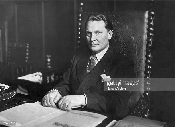 Portrait of Nazi leader Hermann Goering founder of the Gestapo and Minister of Aviation sitting at a desk