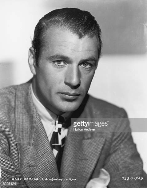 Promotional studio portrait of American actor Gary Cooper , wearing a houndstooth blazer.