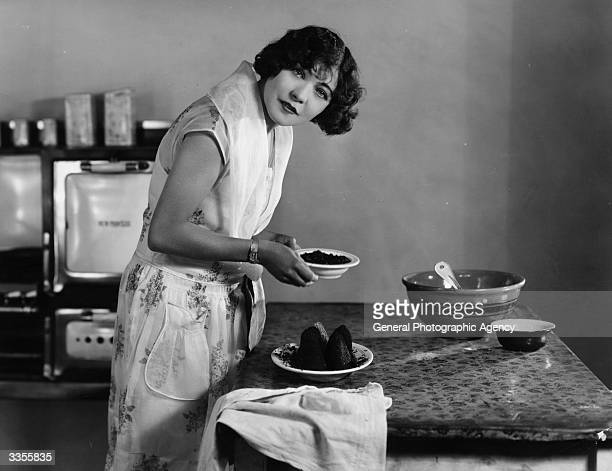 Renee Adoree formerly Jeanne De La Fonte the French leading lady and former circus bareback rider in the kitchen making fish roe croquettes