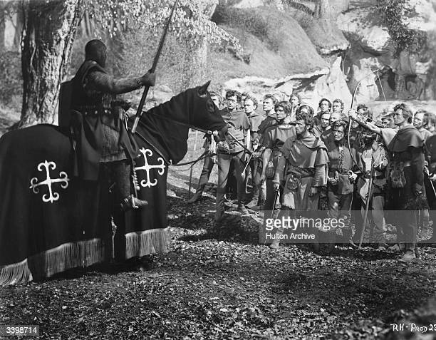 Robin Hood's men confront a mounted soldier in a scene from The Story of Robin Hood a Gaumont British film