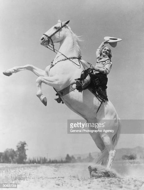 Rodeo rider Ethelyn Dectreaux posing for a painting at Beverly Hills