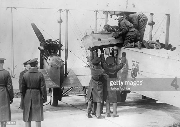 Sergeant Major Jiggs the famous mascot bull dog of the US marines has unfortunately died Here the casket containing his body is being placed aboard a...