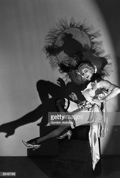 Stage actor Douglas Byng dressed in full drag as a showgirl