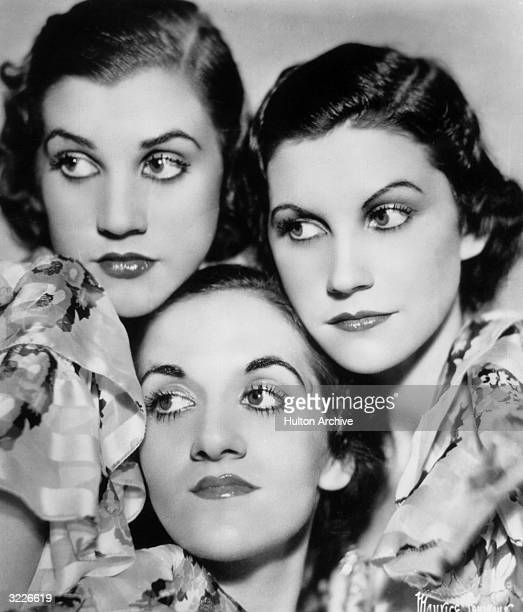 Studio headshot portrait of the American singing group Andrews Sisters posing in ruffled chiffon blouses LR Patty LaVerne and Maxene