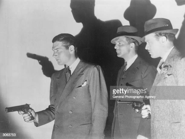 Three men carrying guns.