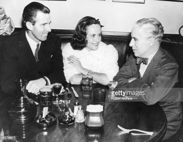 Tim Durant rumoured to be married to Paulette Goddard is seen with her and Charles Chaplin at the Brown Derby Restaurant Paulette Goddard American...