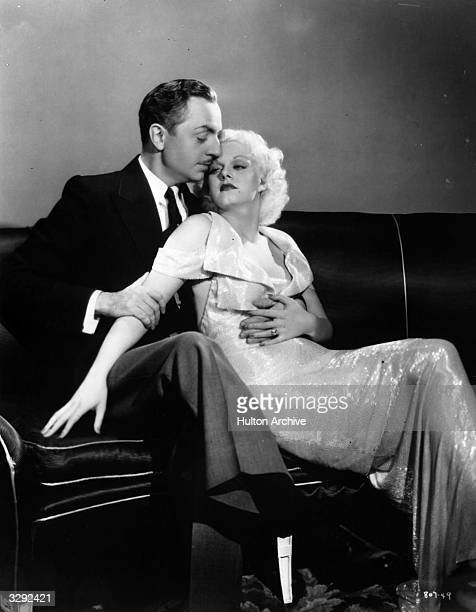 William Powell sits in a close embrace with sultry actress Jean Harlow Their offscreen romance started when they appeared together in 'Reckless'