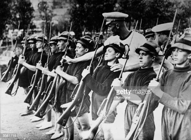 Young boys being taught military drill at a camp near Rome the boys are members of the 'Avant Garde' a fascist youth organisation in Italy
