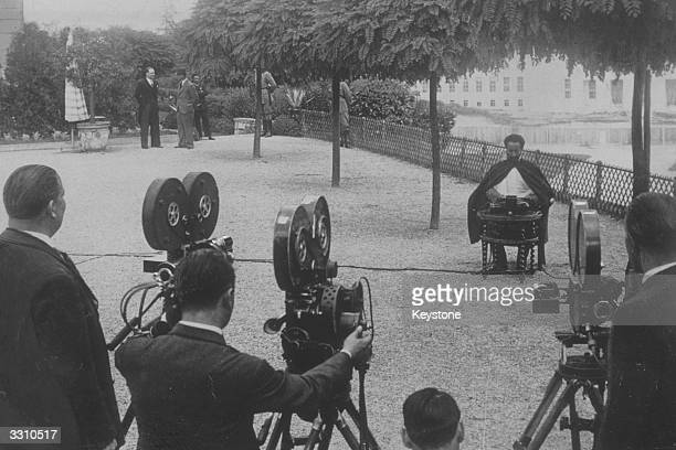 Abyssinian Emperor Haile Selassie posing for the camera during an interview at a hotel in Geneva