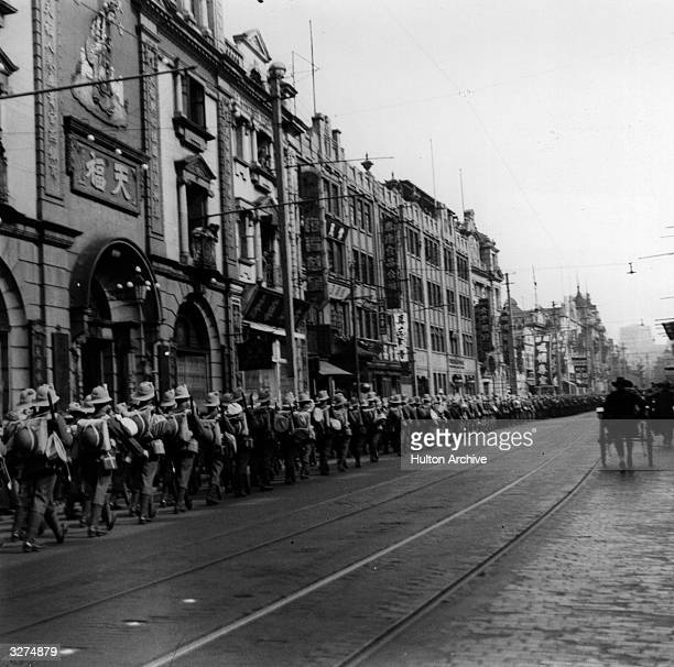 Chinese troops march through the streets of Shanghai during the SinoJapanese conflict