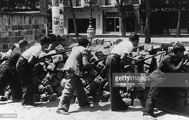 Civilians man the barricades in Barcelona during the civil war