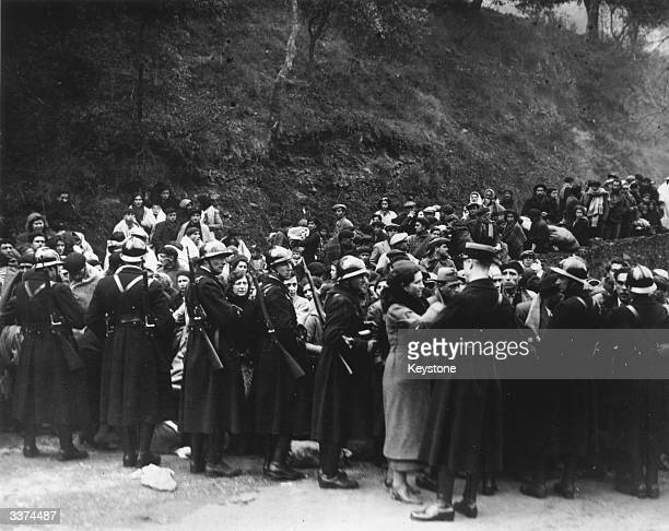 French Mobile Guards keeping back Spanish refugees from the Spanish Civil War, on the French border.