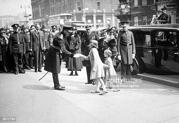 George Duke of York and Elizabeth Duchess of York with their daughters Princesses Elizabeth and Margaret Rose arriving at the Royal Tournament at...