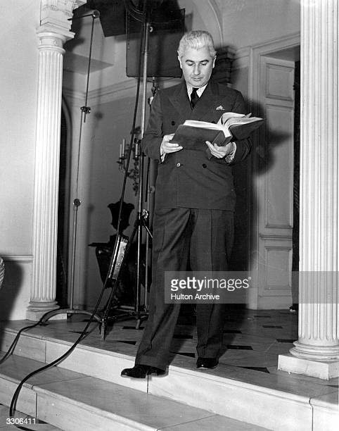John M Stahl the Hollywood director examines the script at MGM for 'Parnell' prior to directing Clark Gable who stars in it