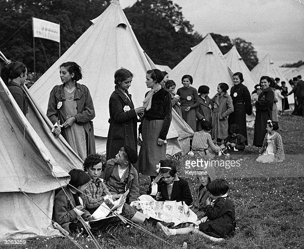 New arrivals still labelled with their name tags on their coats at a camp for refugees of the Spanish Civil War