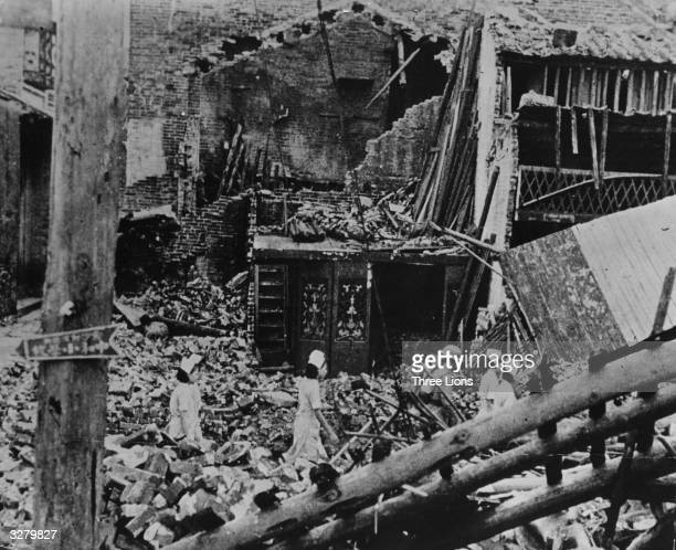 Searching for victims of bombing raids in the ruins of Changsha, during the Sino-Japanese war.