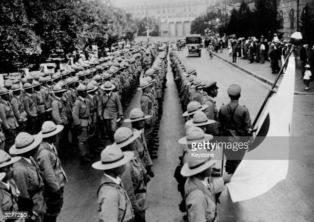 Japanese troops leave Tokyo to take up occupation of Manchuria.