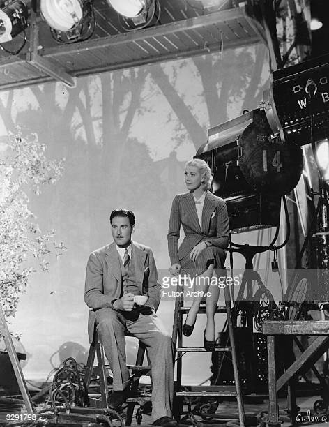 Actors Errol Flynn and Anita Louise on the set of the film 'The Green Light' a melodrama set in the world of medicine The film was directed by Frank...