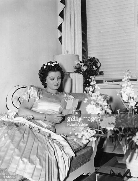 American actress Myrna Loy relaxes in her dressing room during the filming of 'Parnell' directed by John M Stahl for MGM