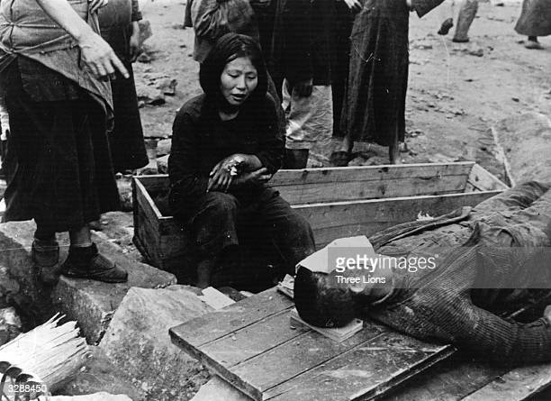 Chinese victims of a Japanese air raid in a town in China during the SinoJapanese War