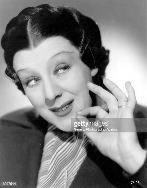 Cicely Courtneidge the British comedienne who was a popular choice in musical comedy is holding her finger and thumb together in a scene from the...