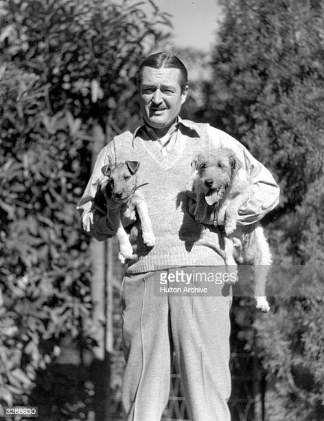Edmund Lowe the Universal film star seen here with his wire haired terriers He appeared in 'American Scotland Yard'