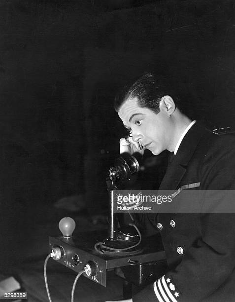 Fernand Gravet the debonair French leading man is telephoning in a scene from the film 'Romance Is Sacred' about a European prince who falls for a...