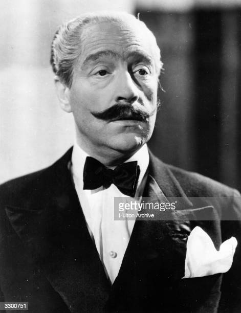 French actor and director Sacha Guitry with a large moustache in one of his many disguises in the French film 'Le Roman d'un Tricheur' or 'The Cheat'...
