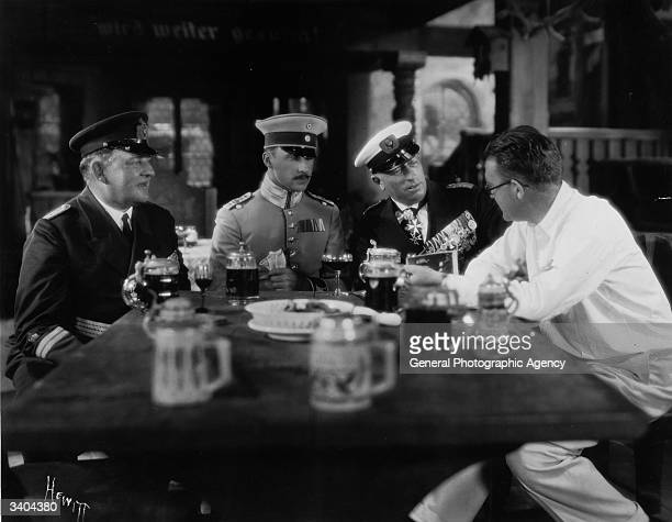 From left to right Captain Lauterbach Archduke Leopold of Austria Count Felix von Luckner and John Ford on the set of 'Four Sons directed by Ford for...