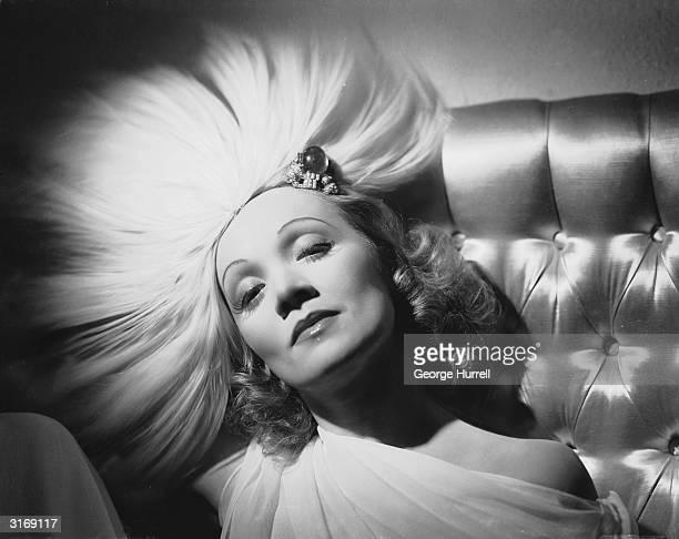 German-born actress Marlene Dietrich wearing a jewelled headdress designed by Travis Banton for the film 'Angel', directed by Ernst Lubitsch.