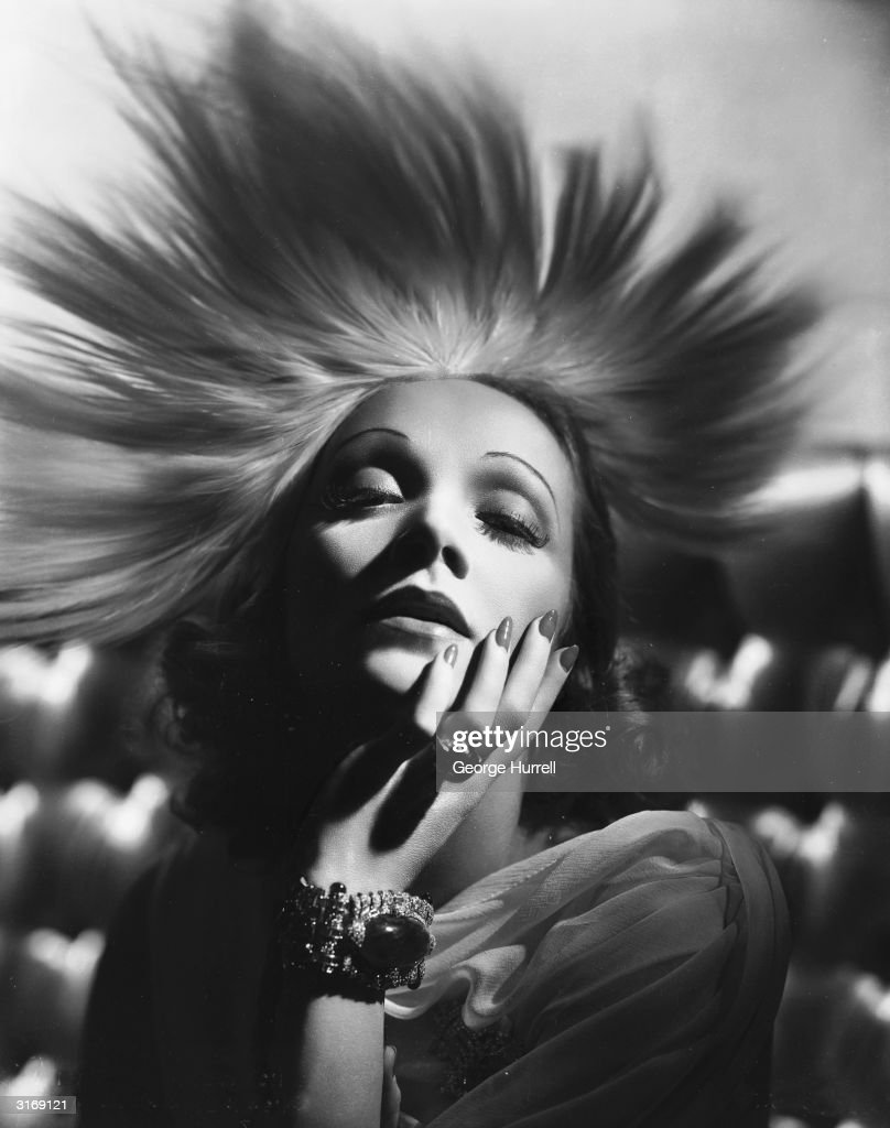 German-born actress Marlene Dietrich (1901 - 1992) wearing an exotic headdress designed by Travis Banton for the film 'Angel', directed by Ernst Lubitsch.