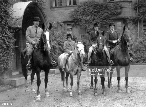 Lord and Lady Digby and their two daughters Pamela and Jaquetta on horseback at their home in Dorset