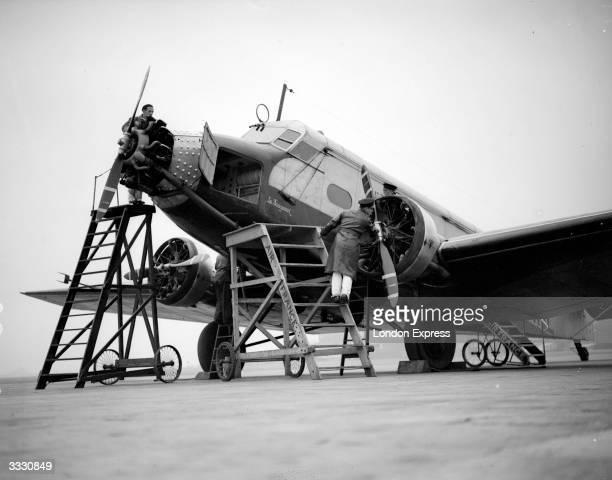 Mechanics workking on an Air France passenger plane 'Le Fougueux'