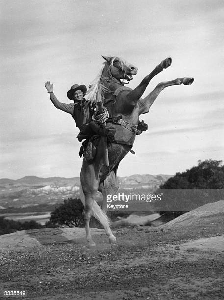 Roy Rogers , born Leonard Slye, the American singer and cowboy who became a major star, with his horse 'Trigger'.