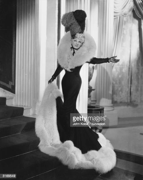 The original Hollywood sex symbol, Mae West in a coat with heavy fur trim.