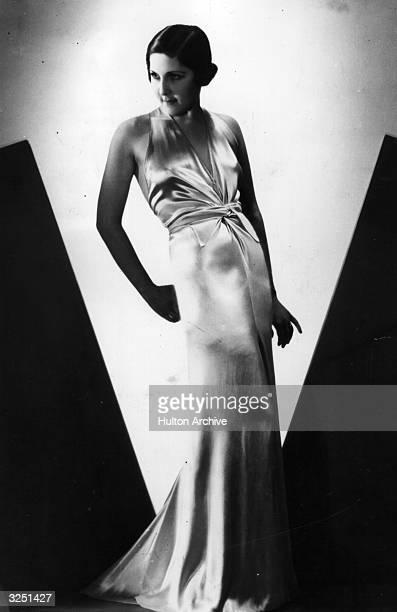 A body hugging silken halternecked dress