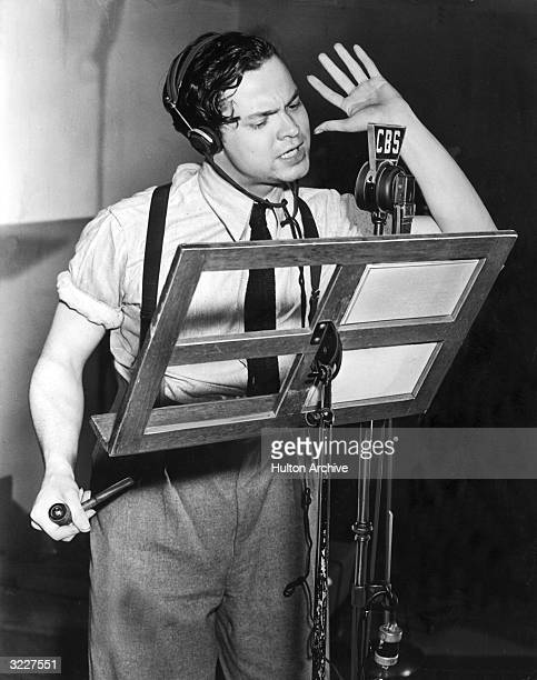 American actor producer and director Orson Welles speaks into a microphone during a broadcast of his CBS radio program 'First Person Singular' Welles...