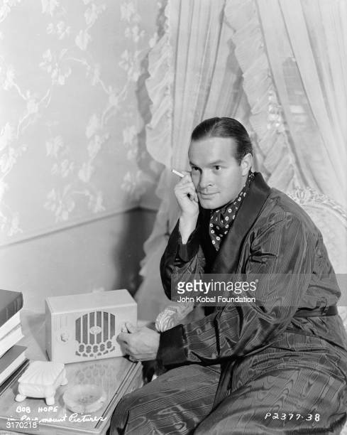 American comedian and actor Bob Hope listening to the radio. He was born in Eltham in Kent but raised in Ohio after his family emigrated.