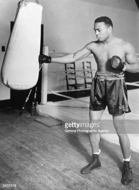 American light heavyweight world champion boxer, John Henry Lewis, training for his contest against Len Harvey.
