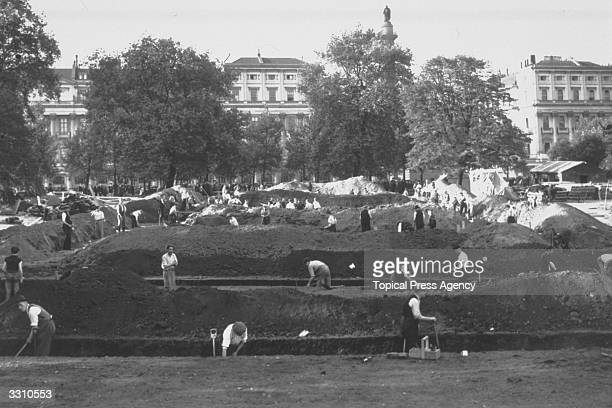 ARP workers digging trenches for airraid shelters in St James Park London