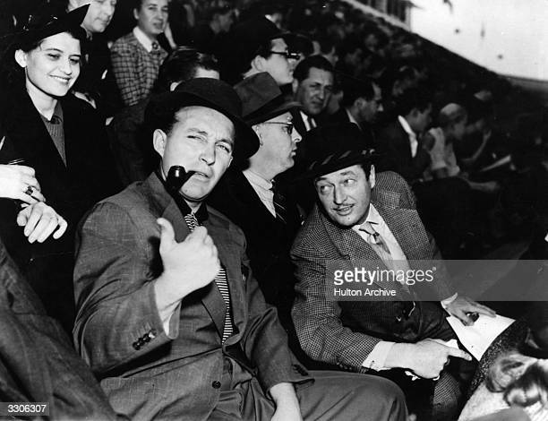 Bing Crosby the film star actor and singer at a football match with Edmund Lowe