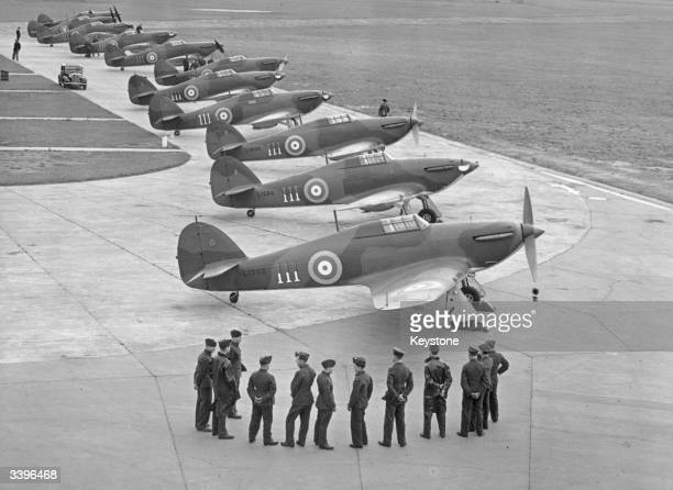 British Airforce Hawker Hurricane I eight gun monoplane fighters on a military runway shortly after their release