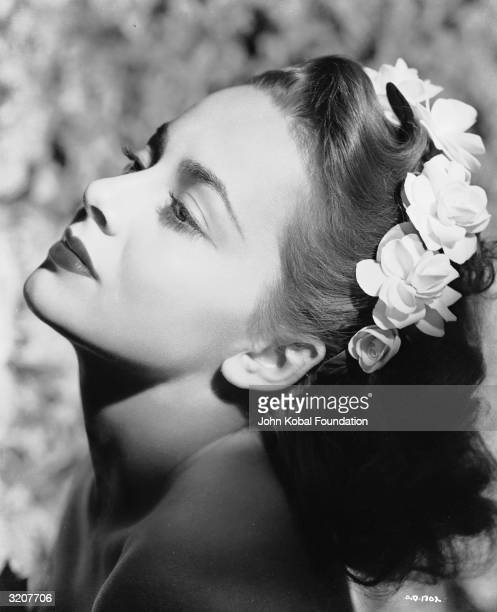 Britishborn actress Olivia de Havilland wearing a crown of blossoms